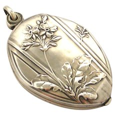 Beautiful art nouveau French 800-900 silver slide locket , primula spring flowers