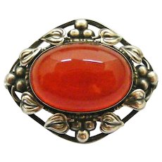 Arts and crafts sterling silver brooch , carnelian, leaves and berries