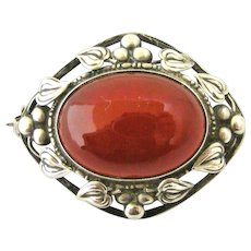 Arts and Crafts sterling silver carnelian brooch leaves and berries.