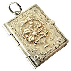 Antique continental 800 silver repousse stamp holder book locket