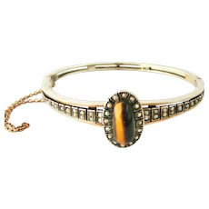 Antique Austro Hungarian silver bangle with seed pearl and tiger eye
