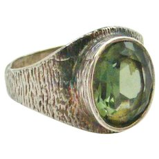 Vintage mid century modernist signet ring set with a faceted green tourmaline