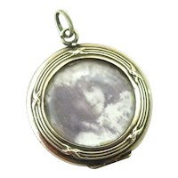 French silver locket in 800-900 silver with faceted glass