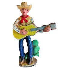 "Vintage 1930's Cast Iron Bottle Opener ""Guitar Playing Cowboy"""
