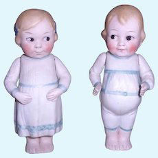 Adorable Small Pair of Googlies with Molded Clothes
