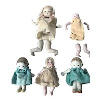 Five miniature all bisque baby dolls, 3 need re-stringing
