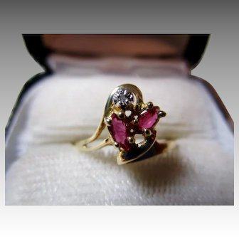 Unusual Rubies  and Diamond Ring set in 10K Yellow Gold