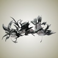 Black Feathers Attached to Wire