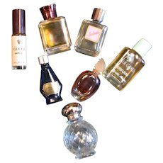 Seven Miniature Different Perfume Bottles