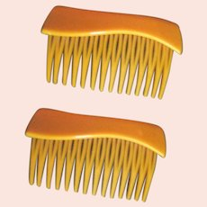 Pair Of Yellow Plastic Hair Combs