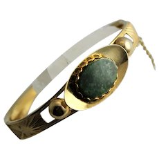 Gold Tone Bangle With Green Stone Center Bracelet
