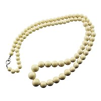 Strand Of Faux Ivory Graduated Bead Necklace