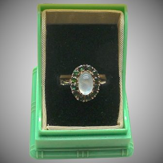 A Lovely 9K Moonstone Ring With Green Tourmalines