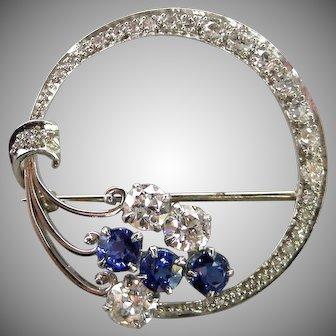 A 1940s Platinum Diamond & Sapphires Crescent Brooch
