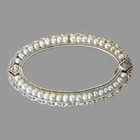 Antique Oval Brooch with Seed Pearls, and Rose Cut Diamonds set in 14 Karat White Gold
