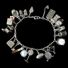 Vintage Sterling Charm Bracelet with 21 Charms Many of Them Mechanical