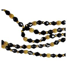 Long Black Glass and Gold Flapper Beads Necklace 54 Inch