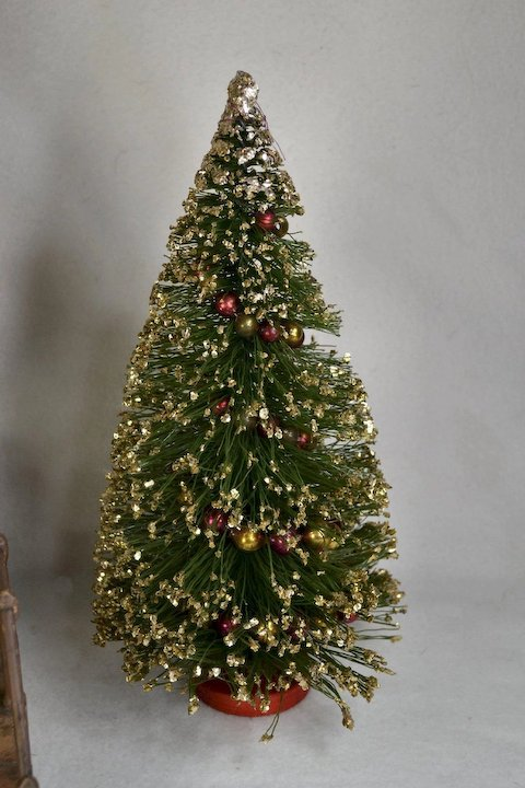 12 inch vintage bottle brush christmas tree trimmed with pink gold small glass garland