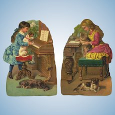 c.1880's Girls Teach Cat & Dogs to Read, Play Piano, Pair Advertising Die Cuts, Arctic Cracker & Spice Co.