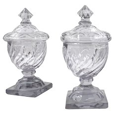 18th Century Pair of English Georgian Cut Swirled Glass Urns with Dome Lids