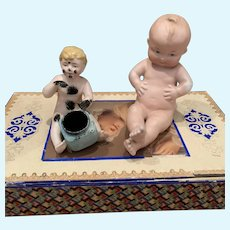 Two Bisque Piano Figures