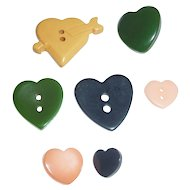 7 Bakelite Buttons Figural Realistic Heart Shape All Different