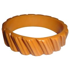 Deco Heavily Carved Butterscotch Bakelite Bangle Bracelet 1/2 in.