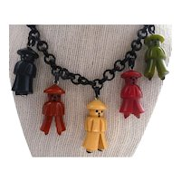 Bakelite & Celluloid 5 Little Oriental Asian Men Charm Pendants on Necklace
