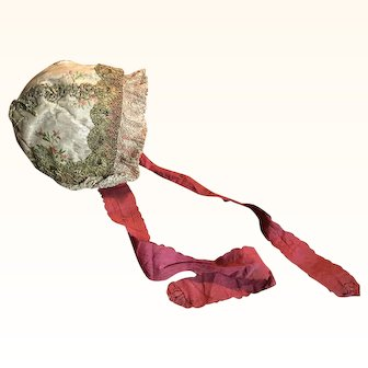 18th Century Spitalfields Silk Baby Bonnet with Original Silk Ribbons and Lined with a rare hand blocked Fabric.