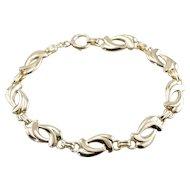 Stylized Double Heart Link Bracelet in 14 Karat Yellow Gold