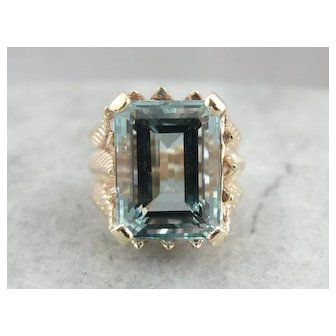 Collector's Quality Deeply Colored Aquamarine in Weighty and Substantial Mounting