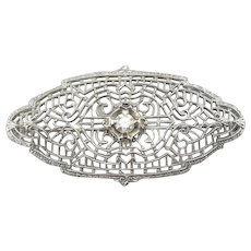 Ornate Filigree Brooch with Diamond Center
