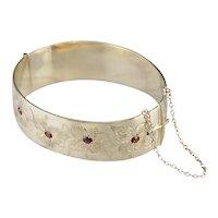 Vintage Garnet Bangle Bracelet with Floral Motif