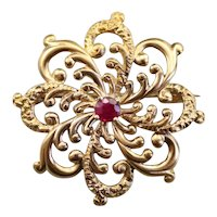 Ornate Scrolling Ruby Brooch