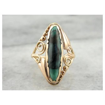 Turquoise Stone in Spiraling Filigree Setting