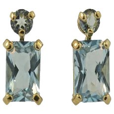 14K Yellow Gold Vintage Blue Topaz Emerald Cut Stud Earrings.