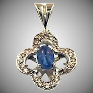 18 Karat White Gold Diamond and Blue Cabochon Sapphire Pendant