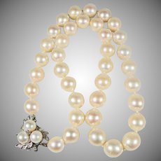 Single strand of 9mm Pearls with 14K white gold diamond & pearl Clasp