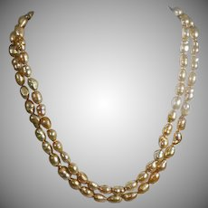 Double strand Vintage Golden Baroque Pearls with 14K yellow Gold Clasp.