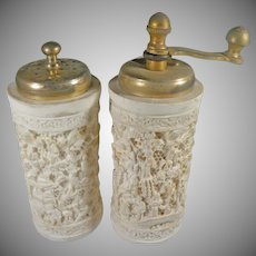 Vintage hand carved bone Ivory colored salt and pepper grinder set