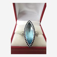 14.23 Carat Blue Topaz and Diamond Accent 18K White Gold Cocktail Ring