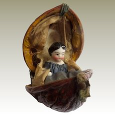 Pink Tint China Doll In Walnut Shell c1860