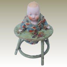 Tiny German Bisque Doll In Baby Walker c1930