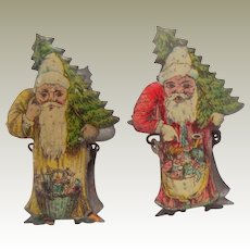 Two Lithographed Santa Candle Clips For Christmas Tree c1910