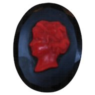 Black Faceted Glass Red Plastic Cameo Oval Tin Back