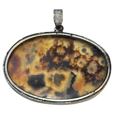 Brown Amber With Inclusions Slice Oval Pendant