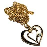 Avon Gold Tone Floating Blue Rhinestone Heart Necklace