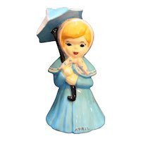 April Showers Girl Bell Pottery Hand Painted Blue Pink