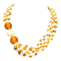 Avon Cosmopolitan Cream Amber Lucite Necklace