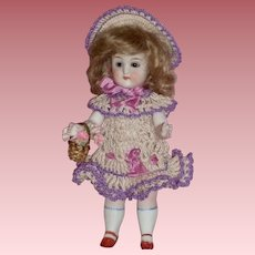 "Sweet 7"" All Bisque German Doll in Knitted Dress & Hat with Basket"